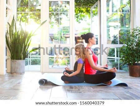 Young brunette woman in a sporty uniform doing yoga on the terra Stock photo © dashapetrenko