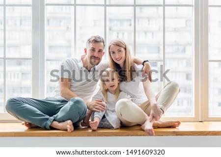счастливая семья отец матери белый дерево Сток-фото © Lopolo