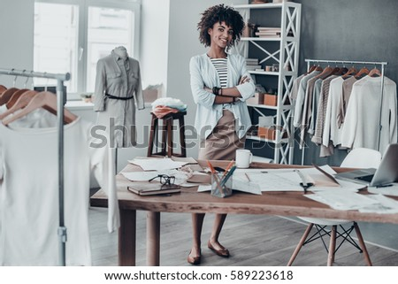 Young successful female fashion designer crossing arms by chest during work Stock photo © pressmaster