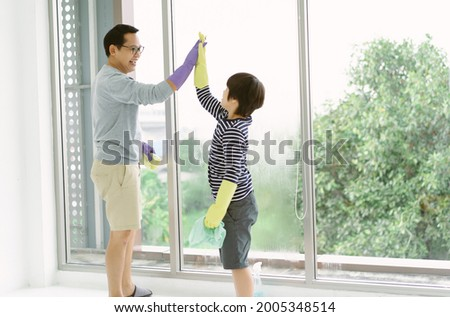 Family, housekeeping, washing concept. Smiling father gives piggyback ride to small daughter gives w Stock photo © vkstudio