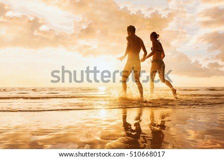 Happy young couple having beach fun on vacation honeymoon travel holidays. Stock photo © ElenaBatkova