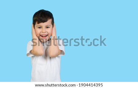 Isolated shot of beautiful Caucasian small child has blue eyes, long dark hair, keeps hands in pocke Stock photo © vkstudio