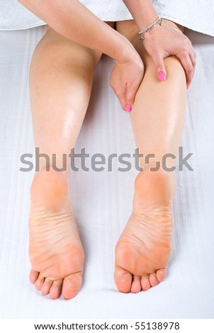 Woman getting leg massage in spa center Stock photo © boggy