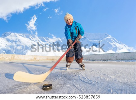 teenager playing hockey outside on a ice rink. Stock photo © Lopolo
