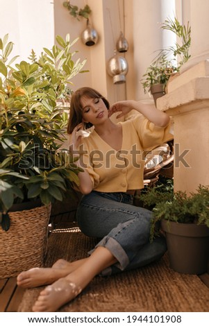 Adorable thoughtful young Caucasian female with light hair, looks aside with pensive expression, con Stock photo © vkstudio