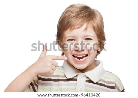 Little smiling child boy hand pointing his first baby milk or temporary tooth fall out Stock photo © galitskaya