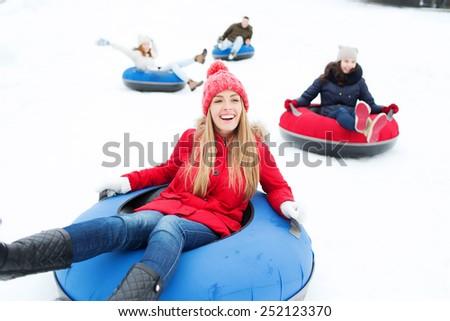 Boy have fun on tubing in the winter. Winter fun for the whole family Stock photo © galitskaya