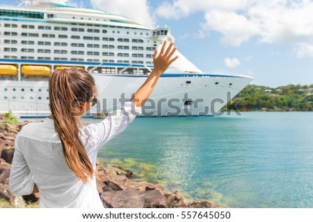 Woman waving hand goodbye at cruise ship leaving. Caribbean luxury travel vacation concept. Boat por Stock photo © Maridav