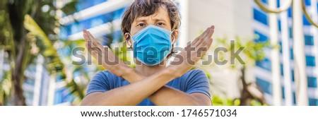 Stop quarantine so as not to kill the business and the economy OR Quarantine to stop corona virus ep Stock photo © galitskaya