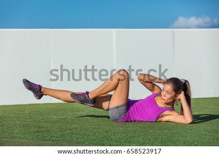 Exercise fitness woman training abs sit up at home. Asian girl doing bicycle crunch workout to train Stock photo © Maridav