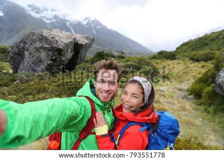 New Zealand travel selfie happy couple backpackers hiking. Travel selfie couple hikers taking smartp Stock photo © Maridav