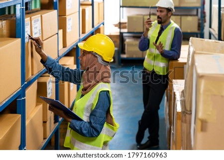 Warehouse manager and muslim worker working inventory Stock photo © vichie81