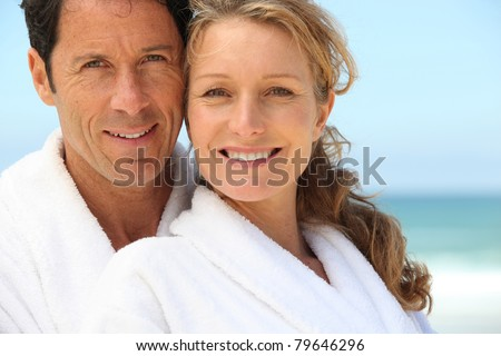 Man vrouw dressing glimlachend strand Stockfoto © photography33