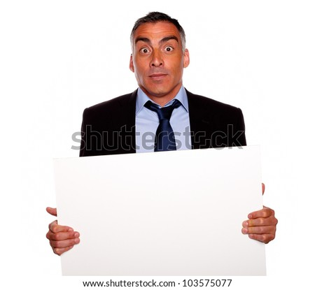 Charismatic businessman holding a white card isolated on a white background  Stock photo © wavebreak_media