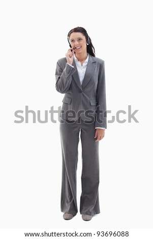 Businesswoman watching on the top speaking in a headset against white background Stock photo © wavebreak_media