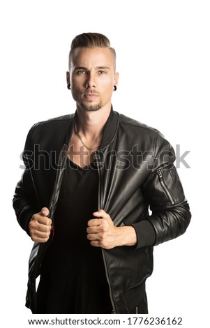 man in leather jacket is standing with his hands in his pockets Stock photo © feedough