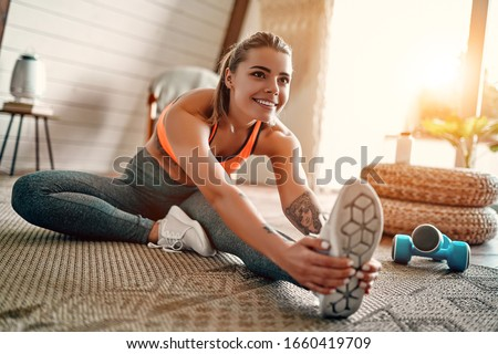 Beautiful woman doing fitness exercise. Stock photo © Nejron