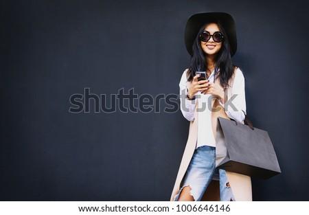 woman holding shopping bags against stock photo © bartekwardziak