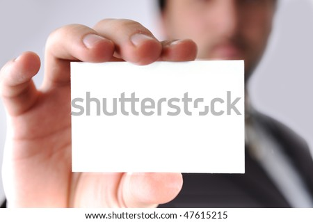 Business man handing a blank business card over white background  Stock photo © deandrobot
