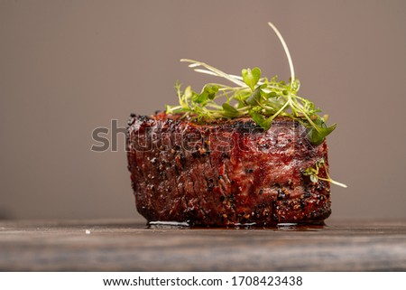 beef filet with spices and vegetables closeup on wooden board Stock photo © OleksandrO