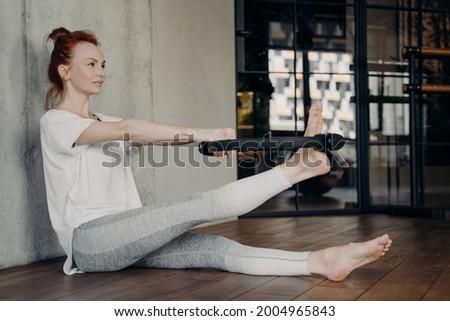 Pilates woman side stretch magic ring exercise Stock photo © lunamarina