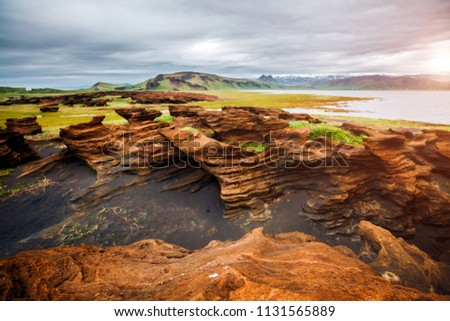 Sandy rocks with by magma formed by winds. Location place Sudurl Stock photo © Leonidtit