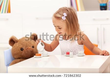 Girl pretending to pour tea Stock photo © IS2