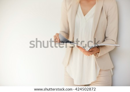 Portrait of gorgeous office woman with long brown hair in white  Stock photo © deandrobot