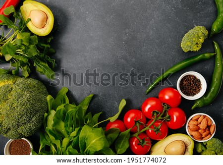 Fresh pepper halves, cherry tomatoes and arugula on a gray background with copy space. Ingredients f Stock photo © artjazz