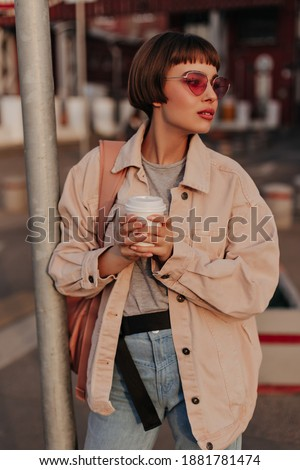 happy girl in brown jacket stock photo © colematt