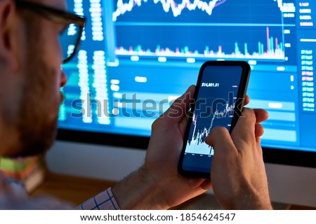 Stock traders looking at finance analysis marketing report tradi Stock photo © snowing