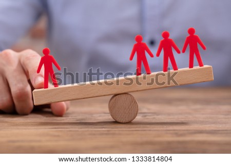 Businessperson Showing Imbalance Between Red Figures On Seesaw Stock photo © AndreyPopov