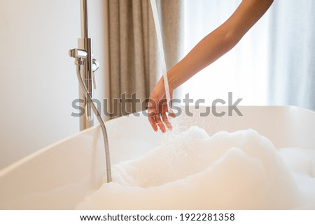 Young restful brunette woman with hand in water Stock photo © pressmaster