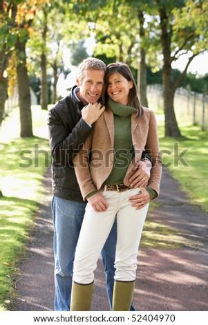Portrait Of Romantic Couple Enjoying Outdoor Walk Through Autumn stock photo © monkey_business