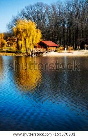 beautiful country house near the lake on a sunny day with clouds stock photo © ruslanshramko