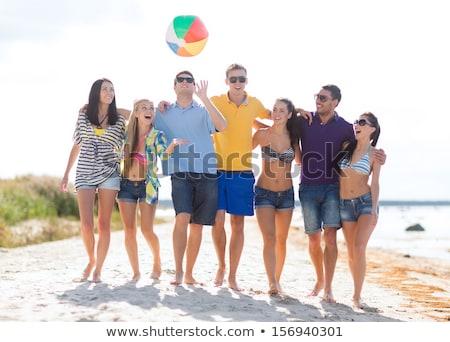 gülen · genç · kız · güneş · gözlüğü · top · plaj · deniz - stok fotoğraf © dolgachov
