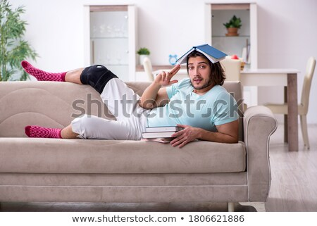 Young student man with hand injury preparing for the exams  Stock photo © Elnur