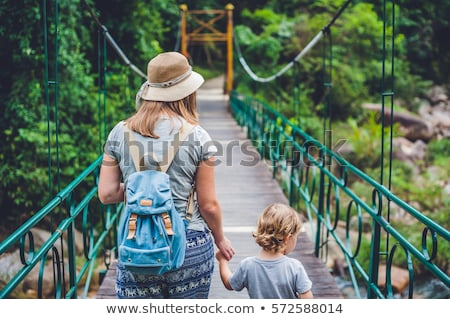 Mother and son are going on a suspension bridge. Traveling with children concept Stock photo © galitskaya