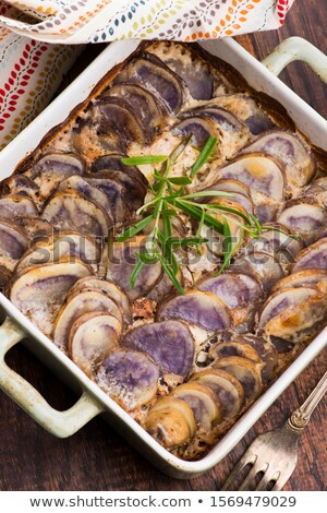 Violet potato gratin with cream and rosemary Stock photo © joannawnuk