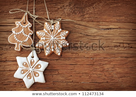 Iced gingerbread cookies by the Christmas tree Stock photo © lovleah