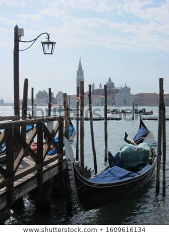 Traditional italian gondolas parking near berth. Stock photo © artjazz