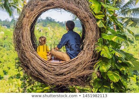 Bali trend, straw nests everywhere. Happy family enjoying their travel around Bali island, Indonesia Stock photo © galitskaya