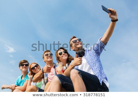 happy couple in sunglasses showing thumbs up Stock photo © dolgachov