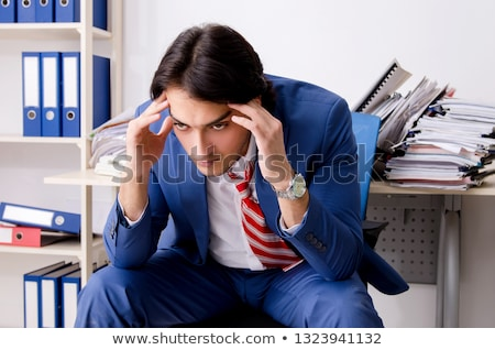 Workaholic Businessman With Headache And Stress Stock photo © AndreyPopov