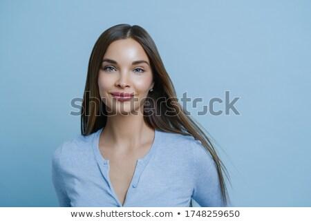 Jól kinéző fiatal nő sötét hosszú haj gyengéd nőies Stock fotó © vkstudio