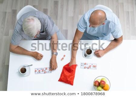 Idős idős játszik lottó gondozó otthon Stock fotó © AndreyPopov