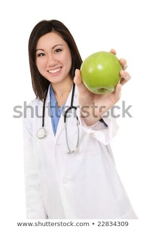 Pretty Asian Nurse with Apple Stock photo © nruboc