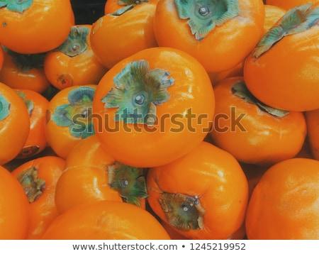 persimmons pile Stock photo © bobkeenan