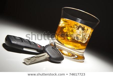 las · llaves · del · coche · whisky · vidrio · claves · dentro · blanco - foto stock © morrbyte