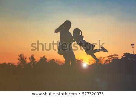 mother and daughter on sunset stock photo © paha_l